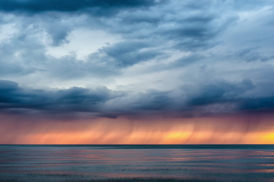 A storm rolling across Lake Erie at sunset.